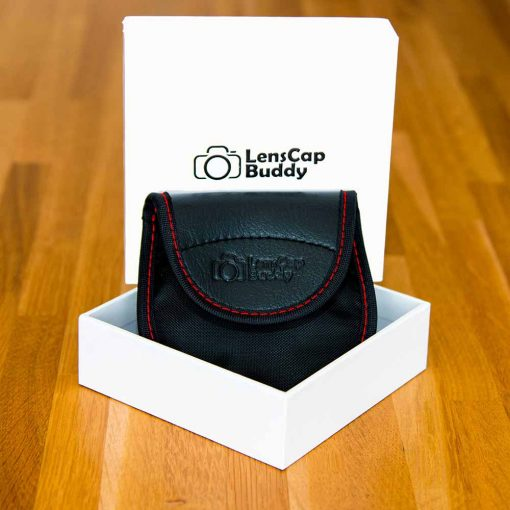 LensCap Buddy for Canon product Front with packaging. Lens Cap