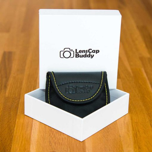 LensCap Buddy for Nikon product Front with packaging. Lens Cap